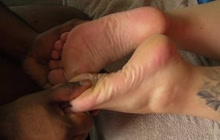 Rubbing her feet