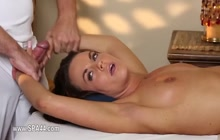 Brunette slut gives handjob to her masseur