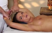 Brunette slut gives handjob to her masseur