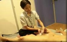 Asian masseur giving handjob